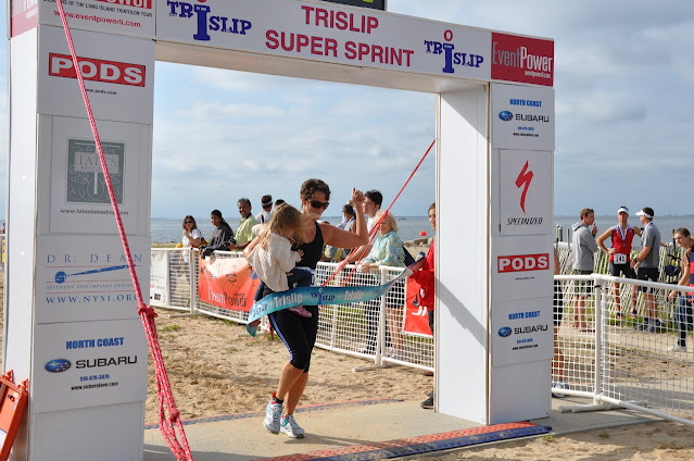 Beth Donovan at the finish line of the TRISLIP! Congrats and thanks for the support!