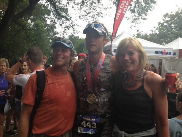 Ben Fenton congratulated by his parents after the NYC Ironman